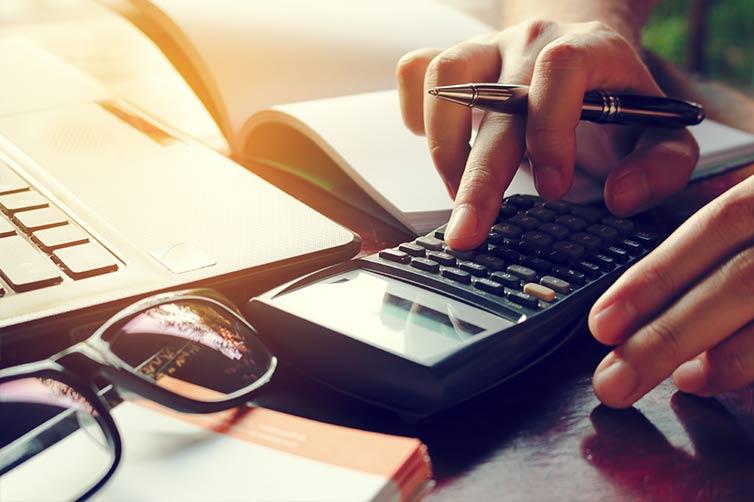closeup of person using calculator