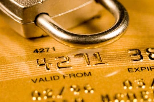 lock on top of a credit card to remind people how to protect themselves from identity theft