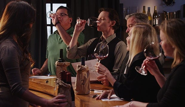 group of people at a wine tasting event