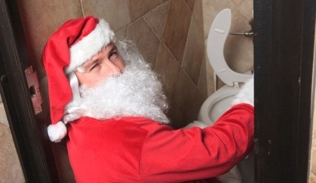 Santa getting ready to puke in a toilet