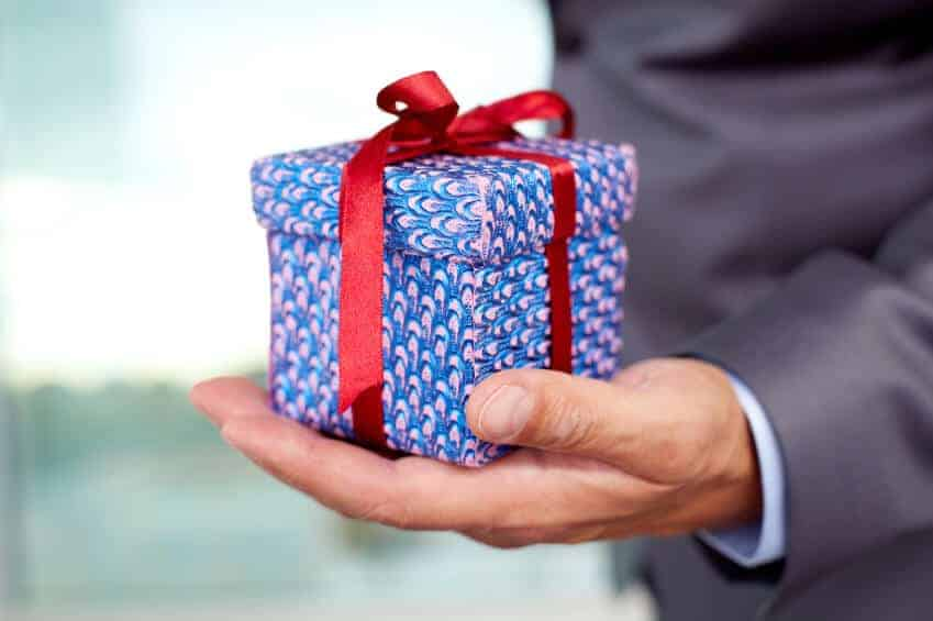 man holding small gift