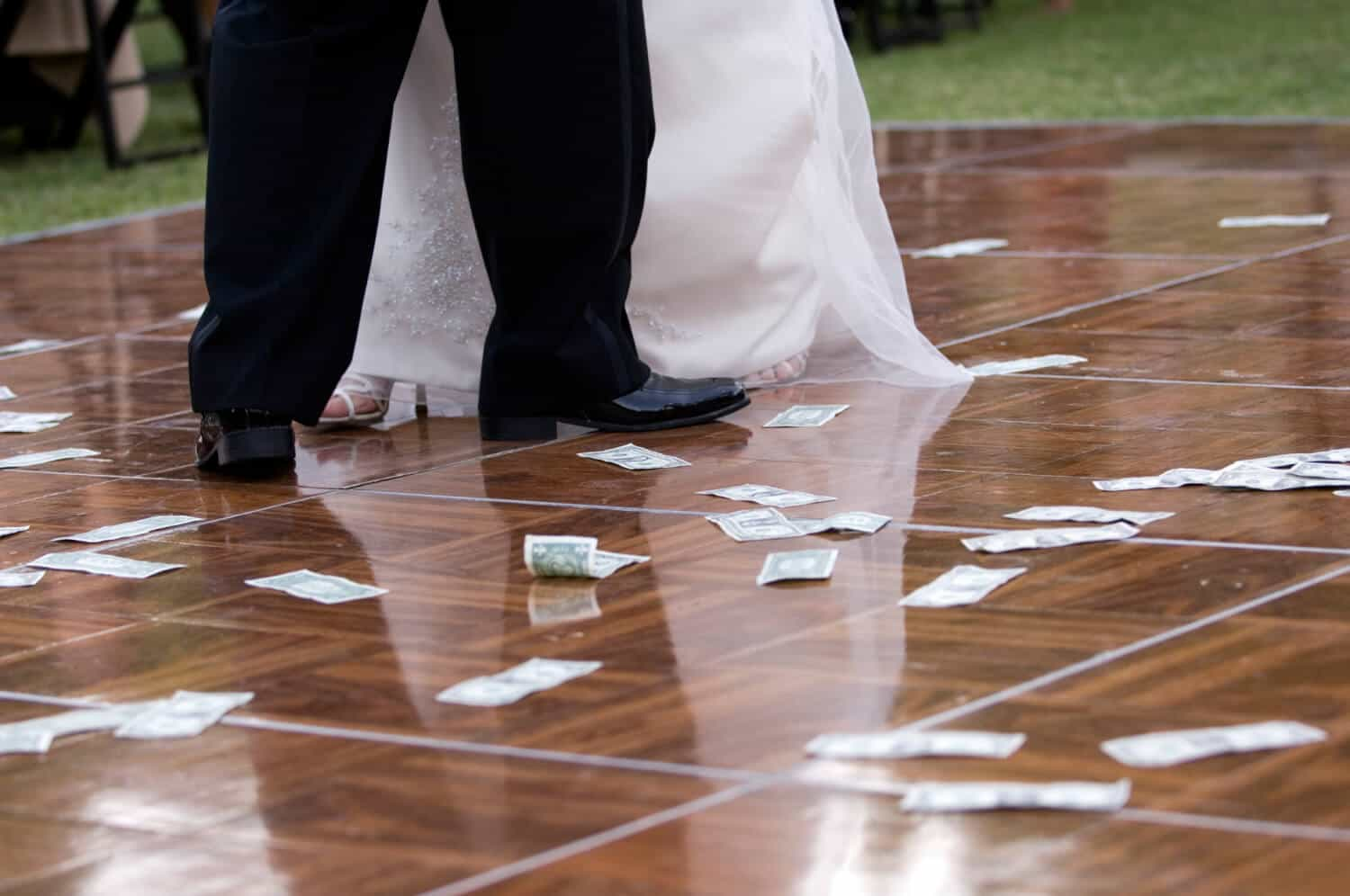 A dancing newlywed couple shows the secret to a happy marriage is keeping money separate