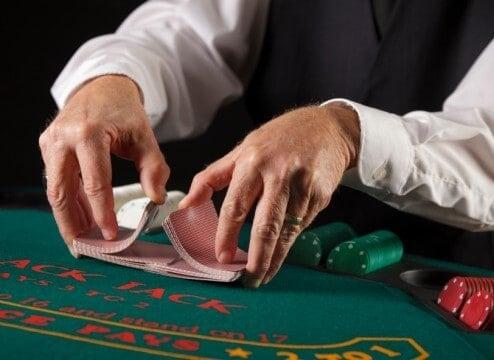 card dealer shuffling the deck