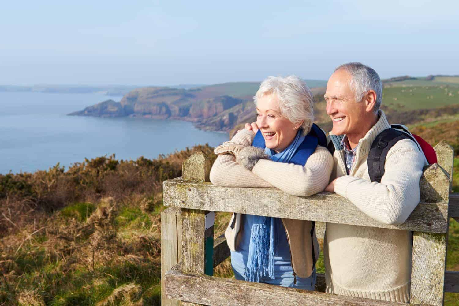 senior couple looking at the landscape at an overlook