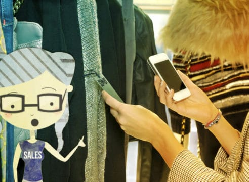 lady doing a qr scan on an item