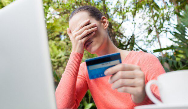 Woman with credit card distraught