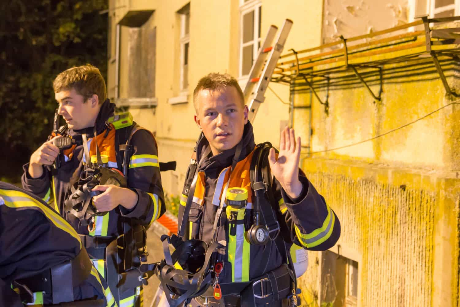 A team of 2 firefighter of a German fire brigade after an exhausting training session with protective gear
