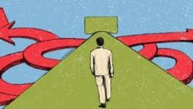 Illustration of man walking towards two paths symbolizing zero percent interest and deffered interest.