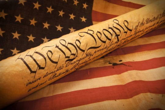 Independence Day image of the U.S. Constitution on top of the American flag