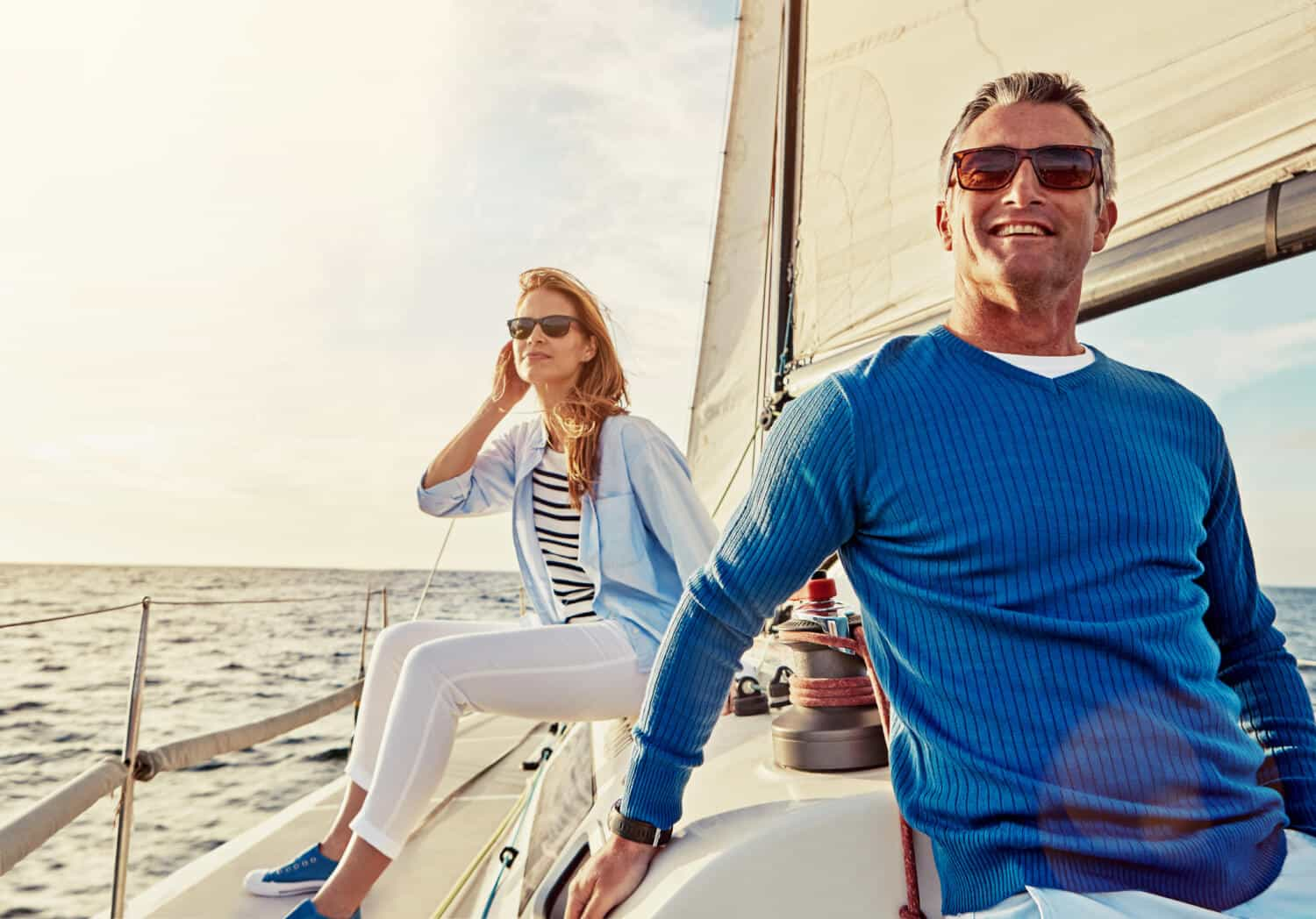 Couple on a sailboat are well off but also may not connect American wealth with having a lot of money