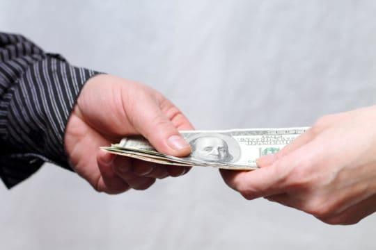 Hand borrowing money from other hand