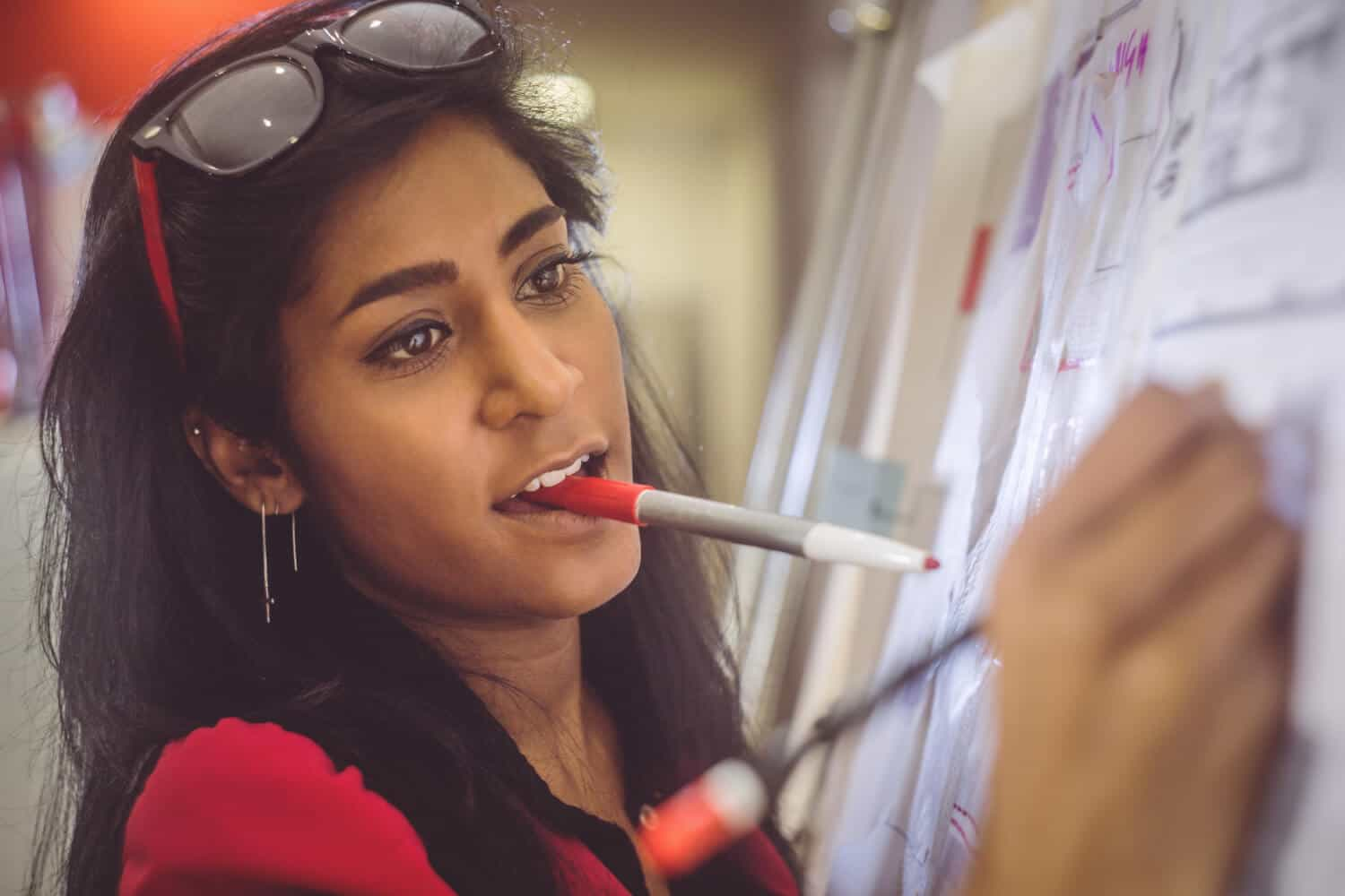 A woman drawing with markers shows how to work side hustles