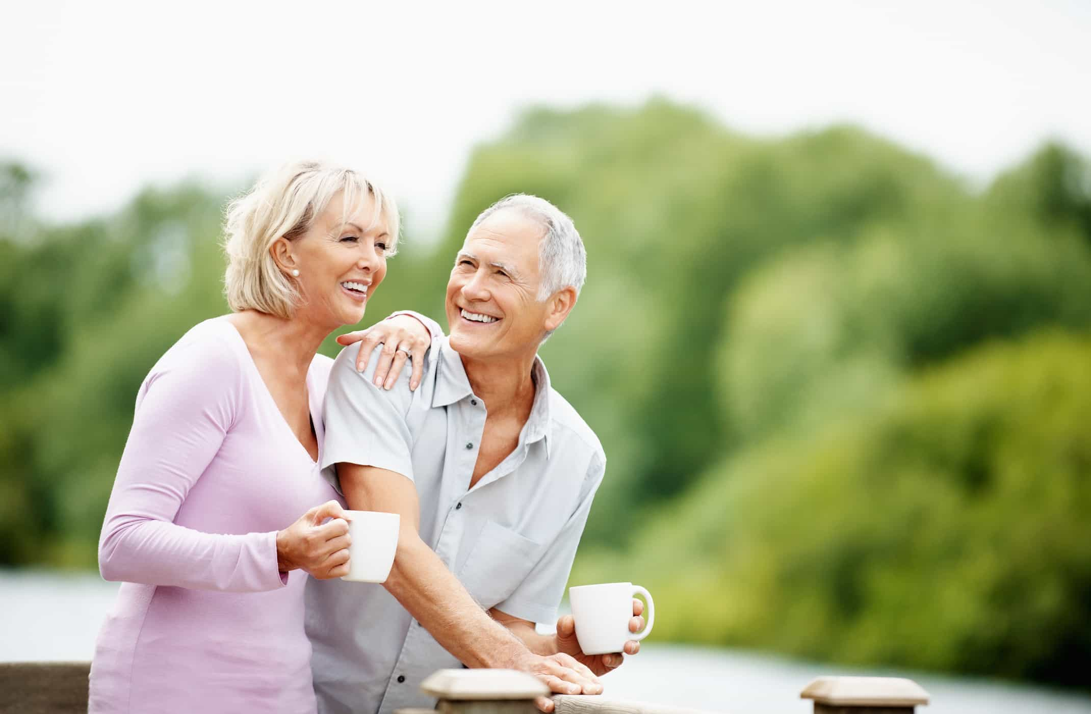 Baby boomer senior couple enjoying a cup of coffee together