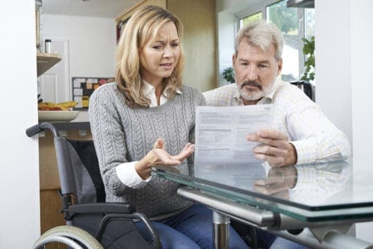 Flustered couple fighting a medical bill