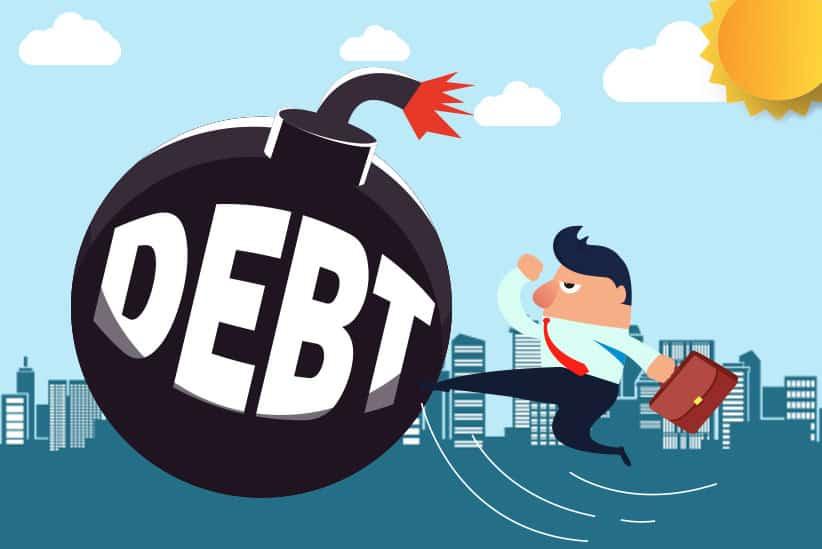 Business Man Karate-Kicking a Debt Bomb
