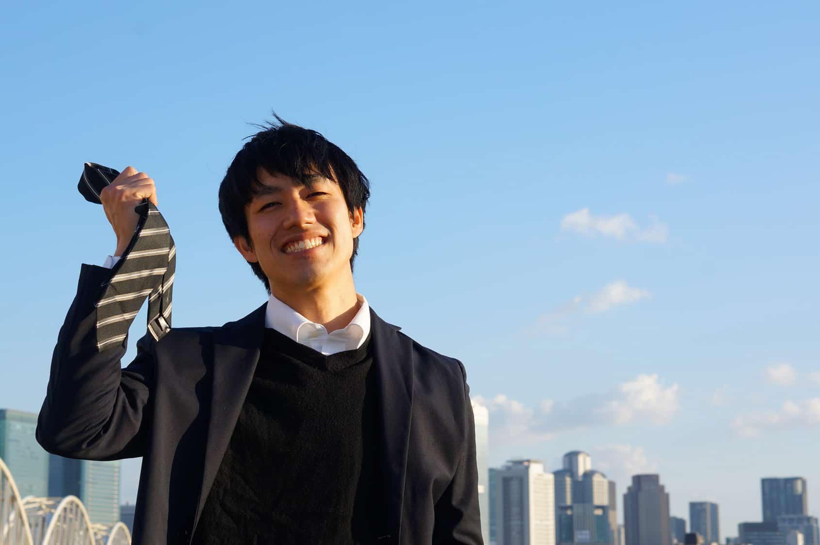 Happy Man Holding Suit Tie