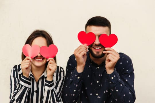 funny couple is happy because they saved money on valentines day