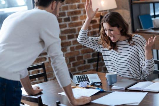 Millennial couple arguing about their debt