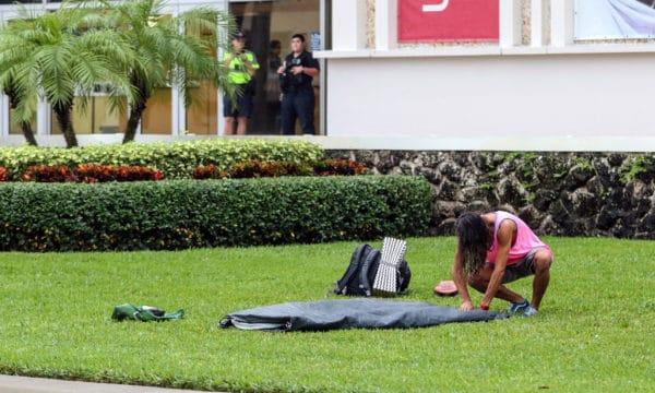 Andrew Fraieli packs up his tent on Florida Atlantic University's campus