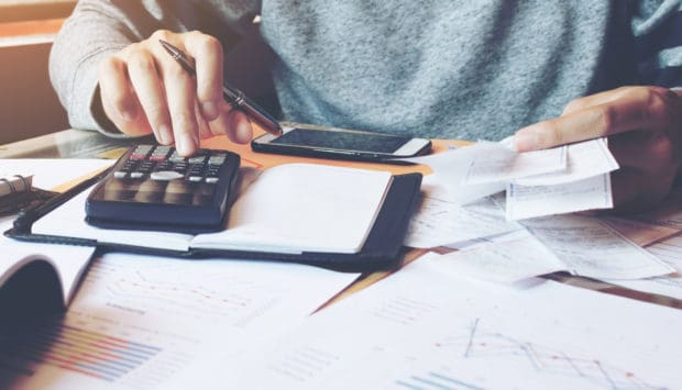 Using a calculator to figure out savings on taxes