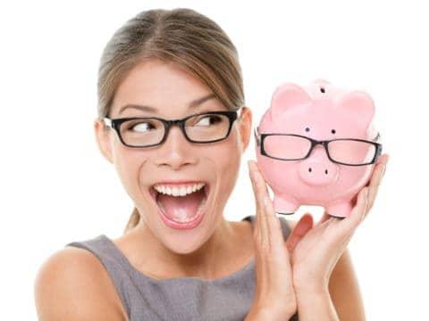 Millennial woman with a smart piggy bank saves a lot