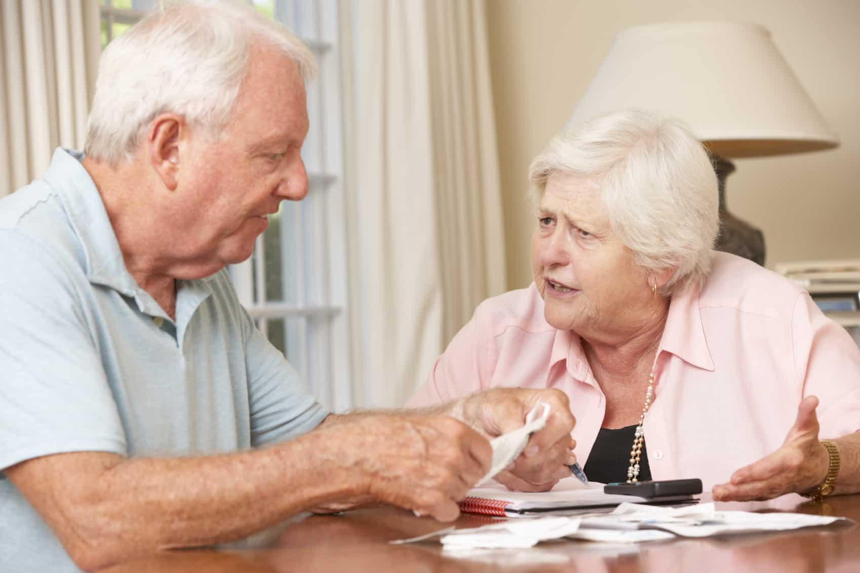 Elderly couple reviewing their bills