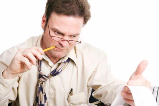Man struggling to do his taxes