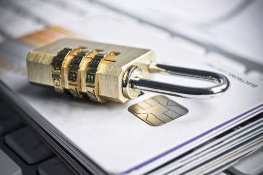 Combination lock on stack of credit cards