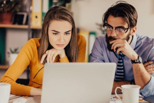 Millennial couple shops online