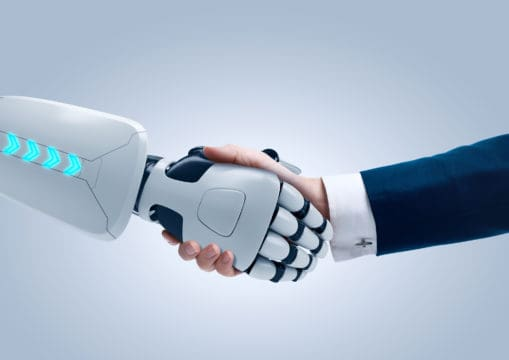 Robot tax assistant shakes hands with a tax filing professional