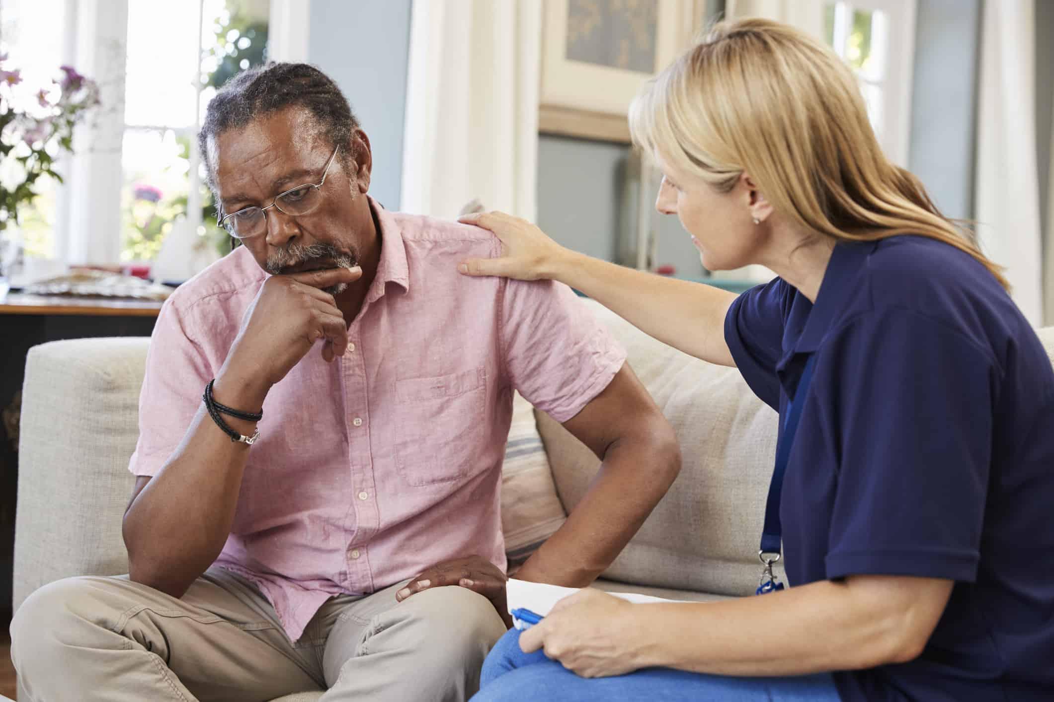 Support Worker Visits Senior Man.