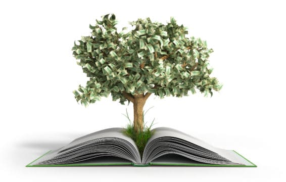"""A """"money tree"""" grows from open book."""