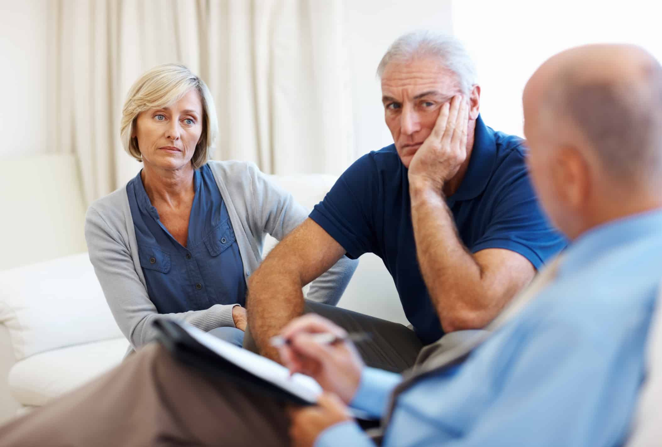 Tense senior couple meeting with their counsellor.