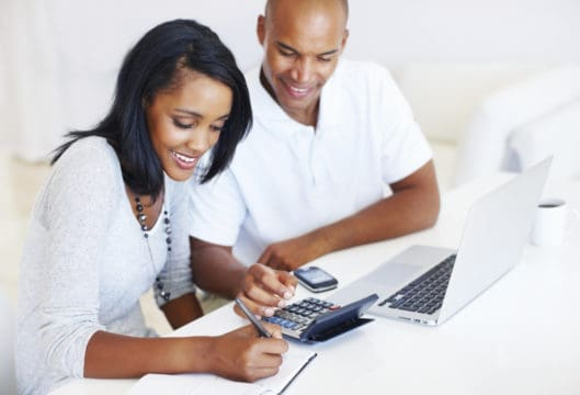 Portrait of young couple budgeting.