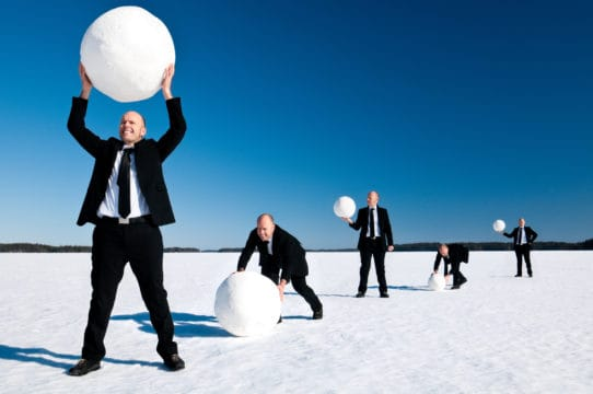 A businessman demonstrates the power of the snowball method of destroying debt