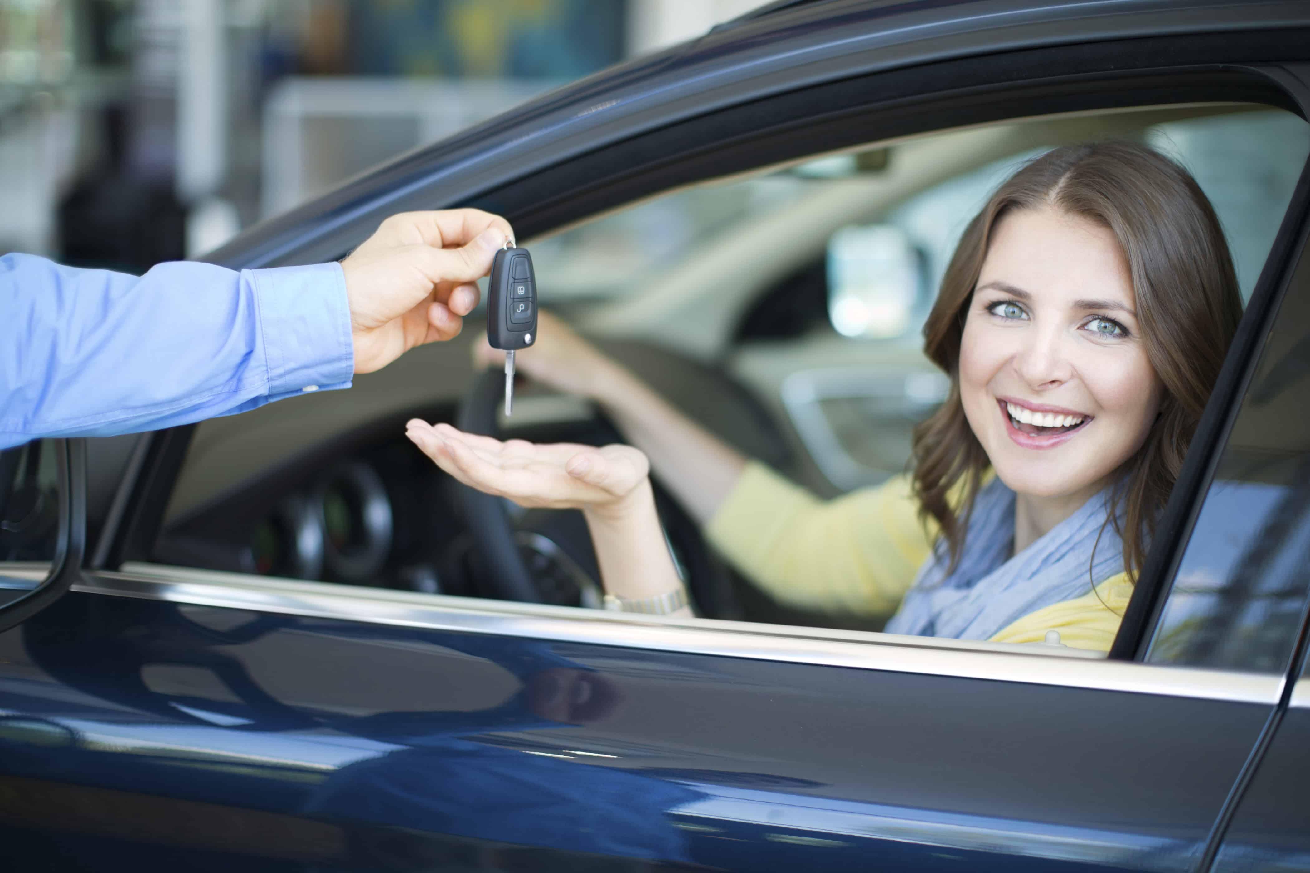 Women gets keys to new car.