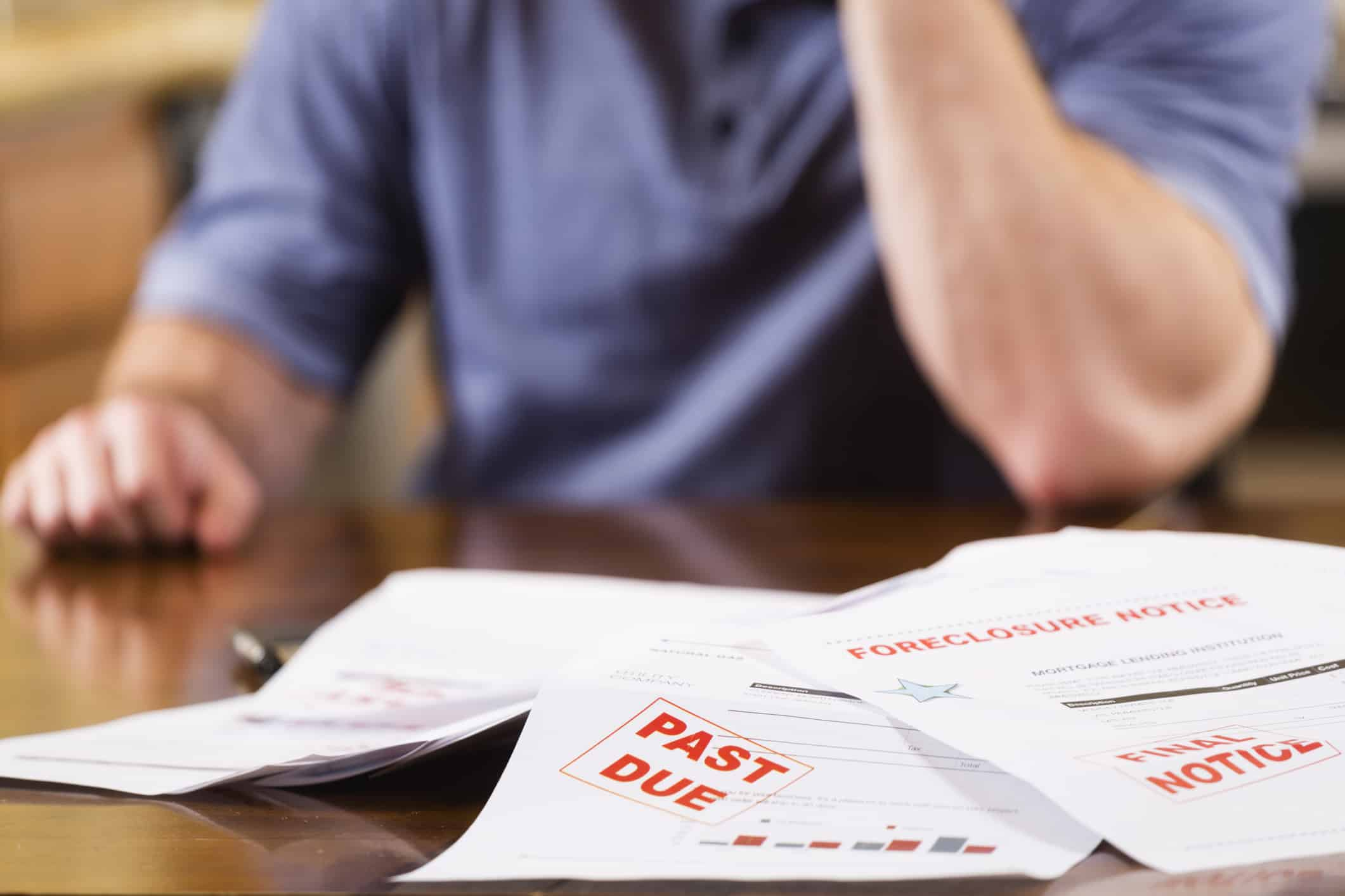 Man struggling to pay overdue bills