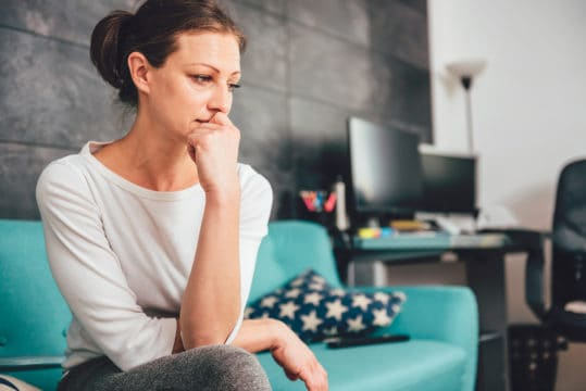 A woman anxious about her finances