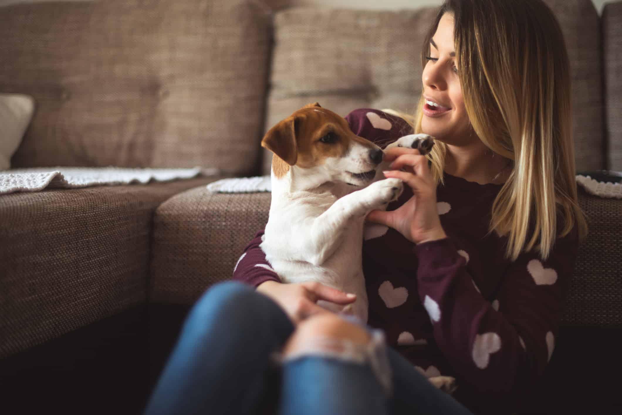 Woman pet sitting as a side hustle