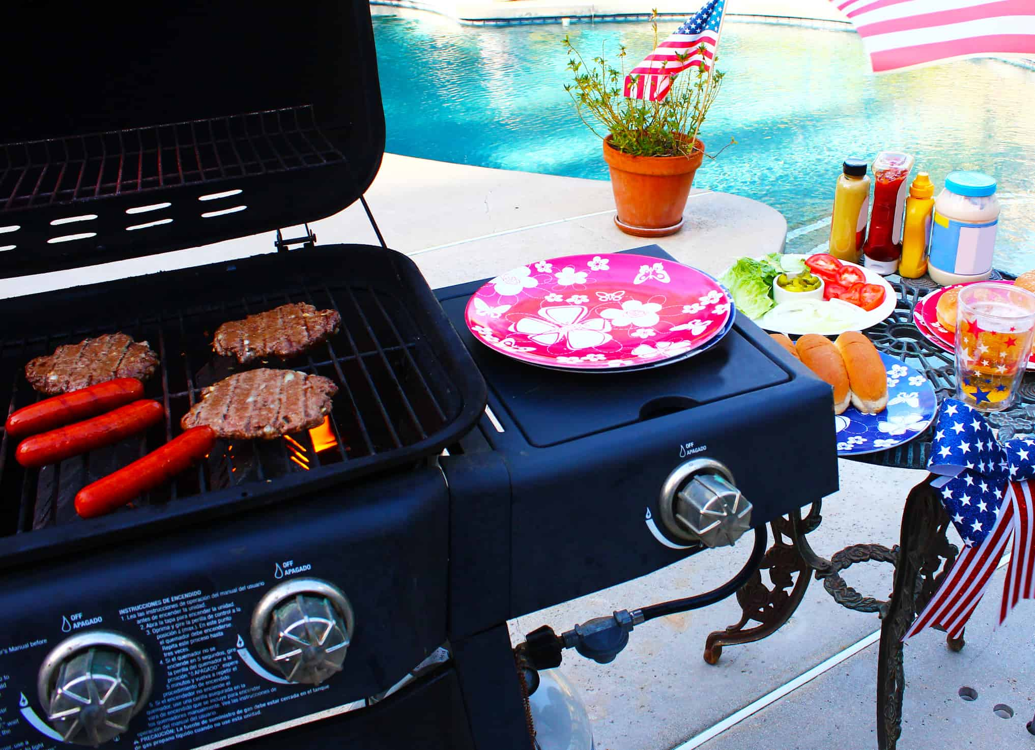 Gas grill by the swimming pool ready to BBQ.