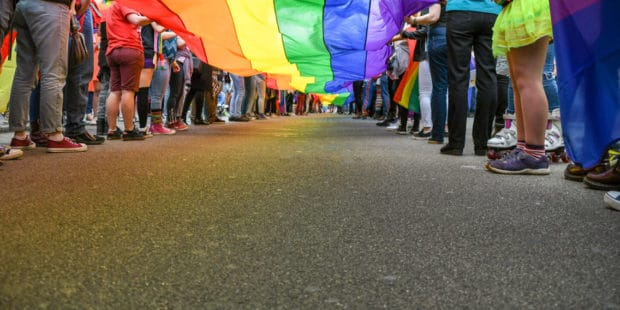 kids holding the gay pride flag financial advice