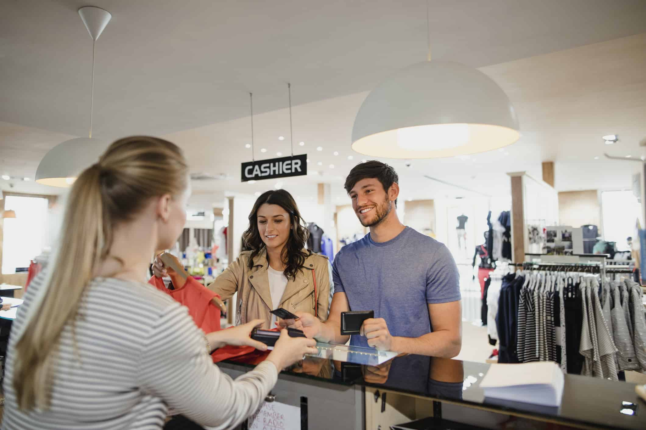 man paying for clothes in one of the highest retail store credit card debt cities