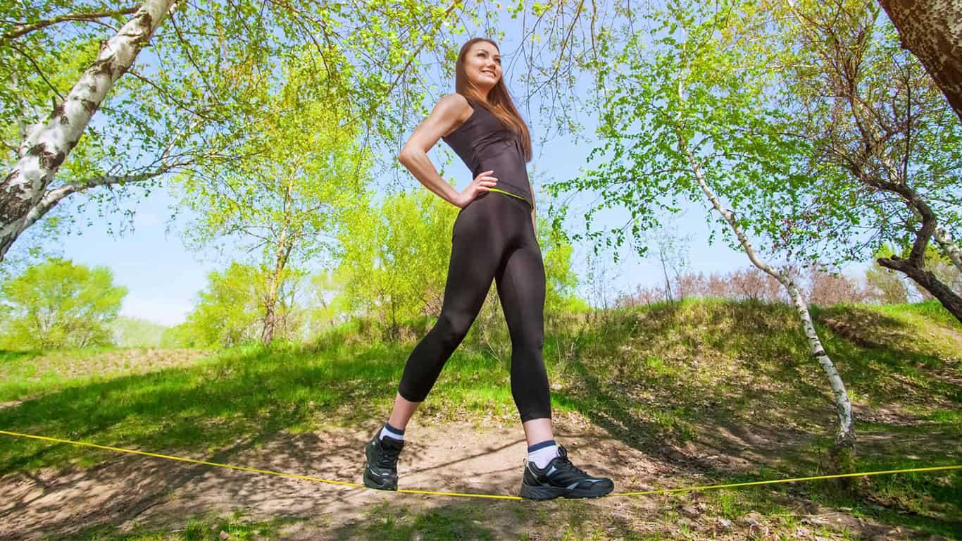 Self-confident woman walks across a tightrope