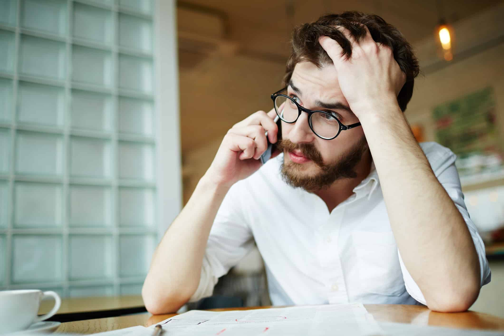 A stressed man demonstrates millennials don't know about money and it's costing them financially and physically