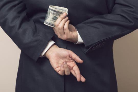 Man committing fraud at work