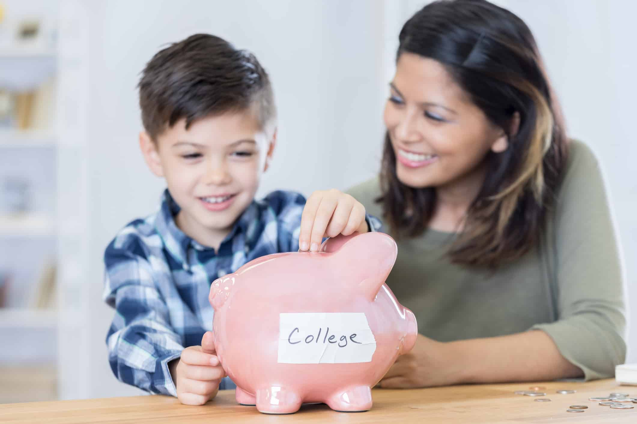 Mother teaching son about saving for his education.