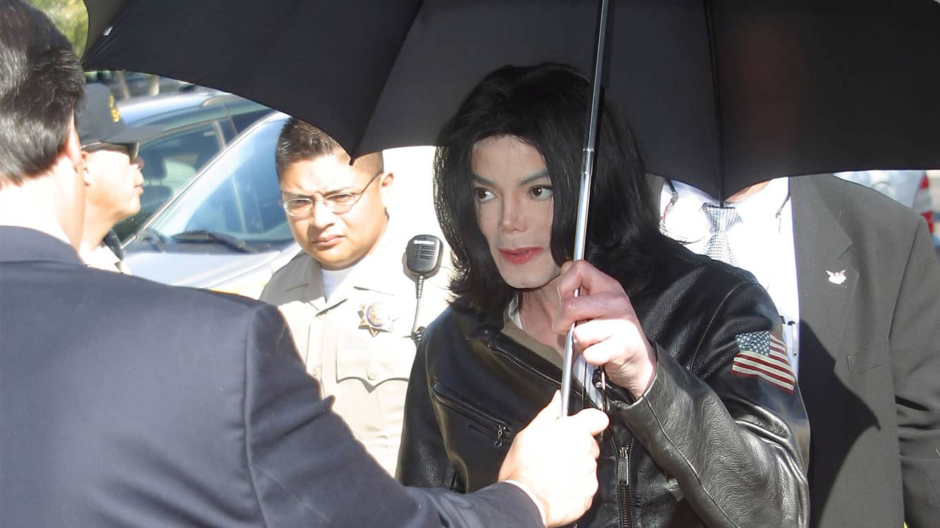 Michael Jackson holding a black umbrella