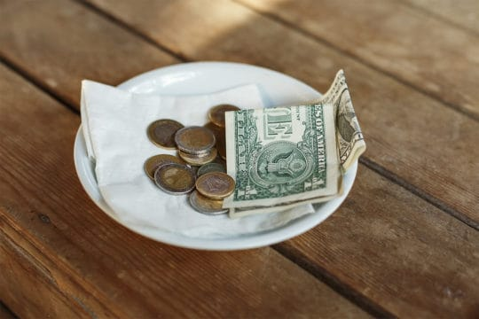 Why tipping is important: Money left on table for server.