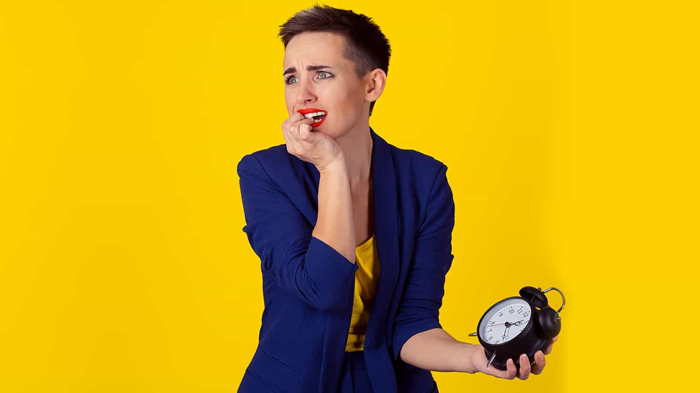 Woman being late to work, alarm clock in her hand