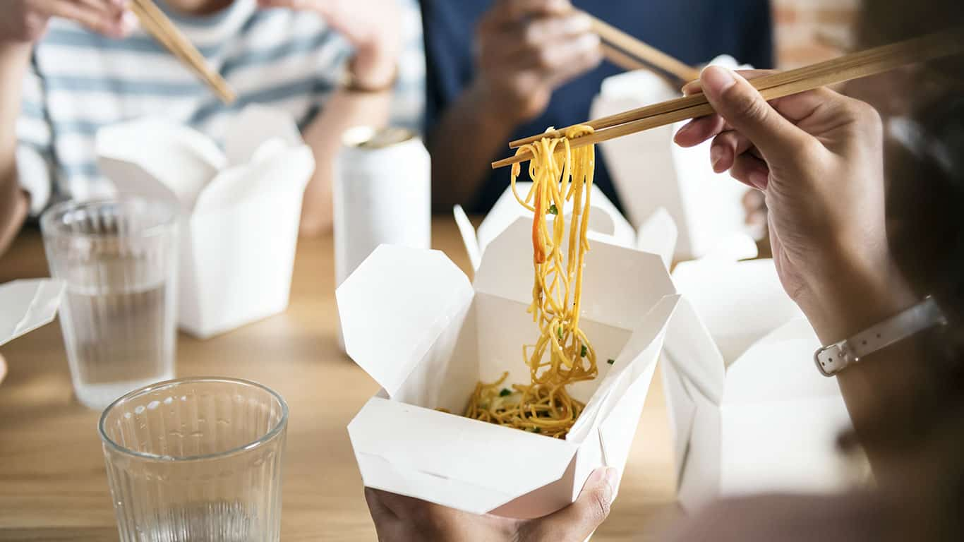 Friends saving money eating Chow mein together